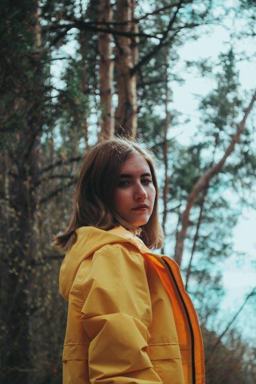 Portrait of Woman in Yellow Coat