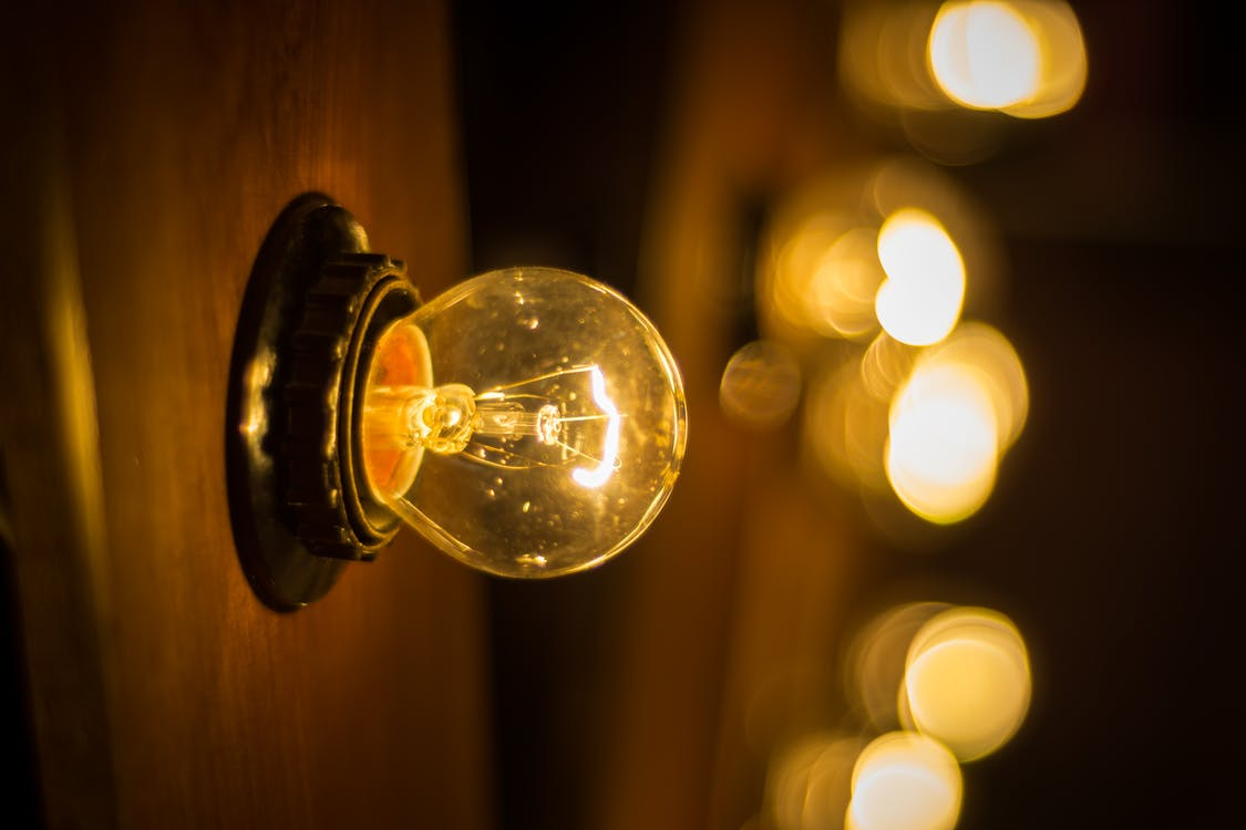 Selective Focus Photography of Turned on Edison Bulb