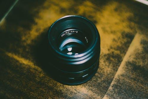Black Camera Lens on Brown