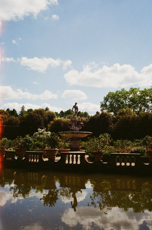 Statue in Park with Pond