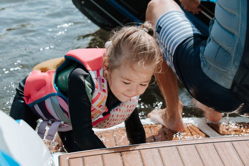 Young Girl Climbing to Boat