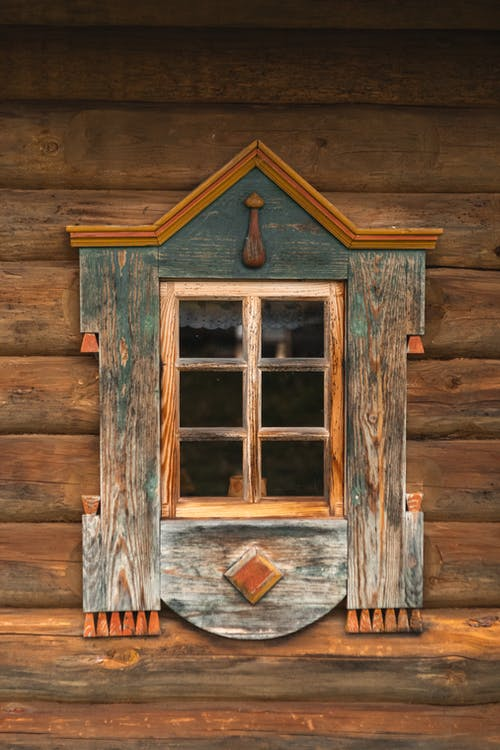 Ornamental Window of Old Wooden Cottage