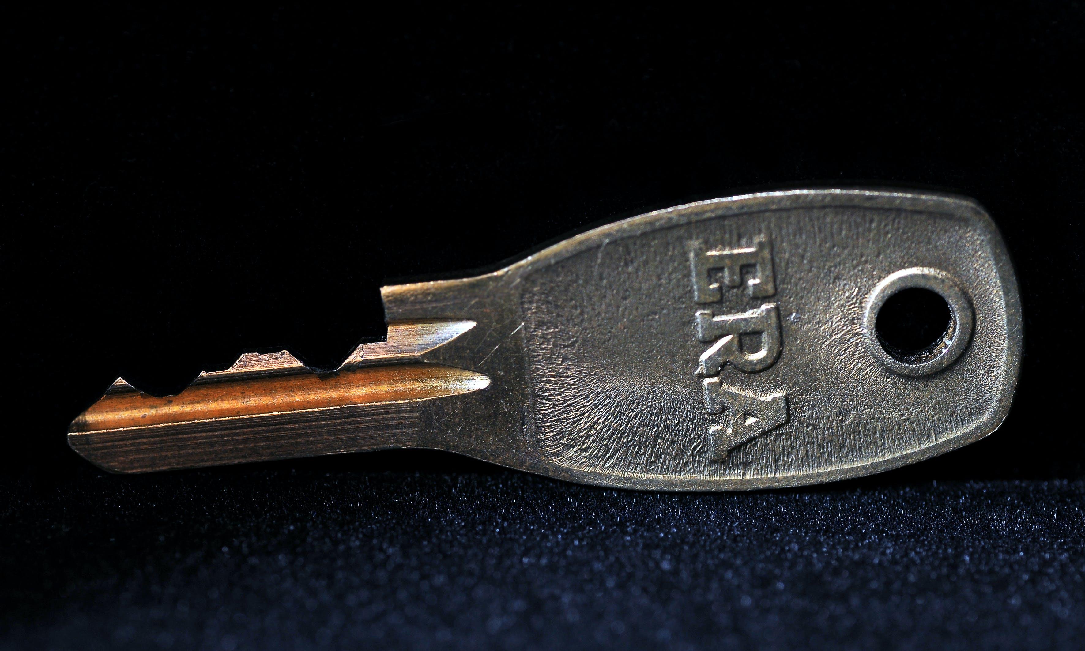 Free stock photo of Macro shot of a small window key