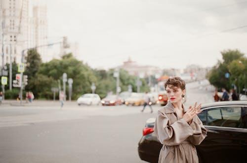 Woman in Coat on Street