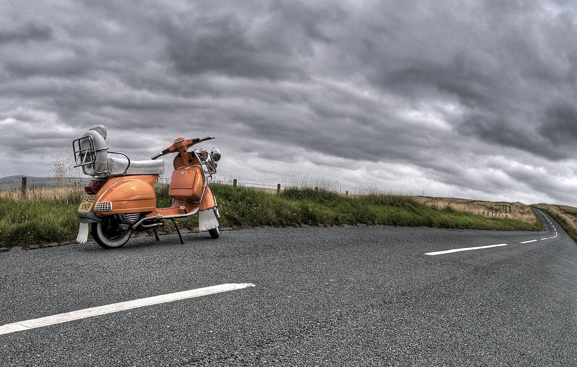Photography of Classic Motorcycle on Road