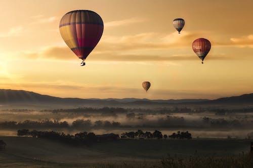 Foto profissional grátis de alvorecer, áreas, aventura, balões
