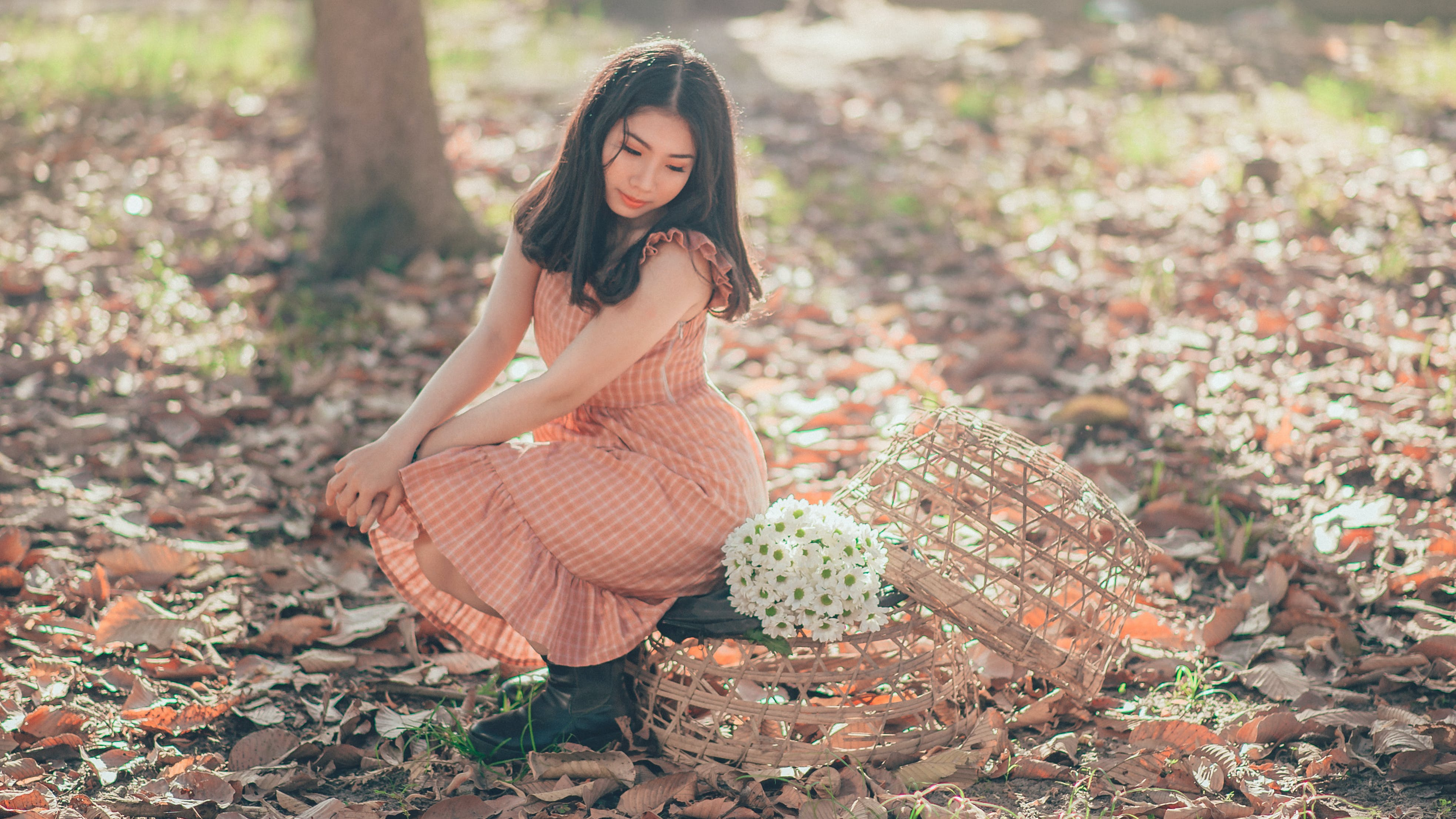 Woman Sitting Beside a Flower Bouquet