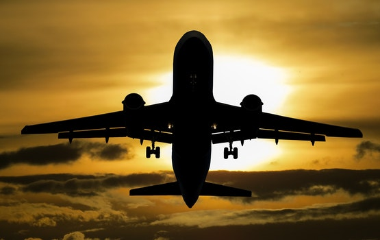 Silhouette of Airplane during Sunset