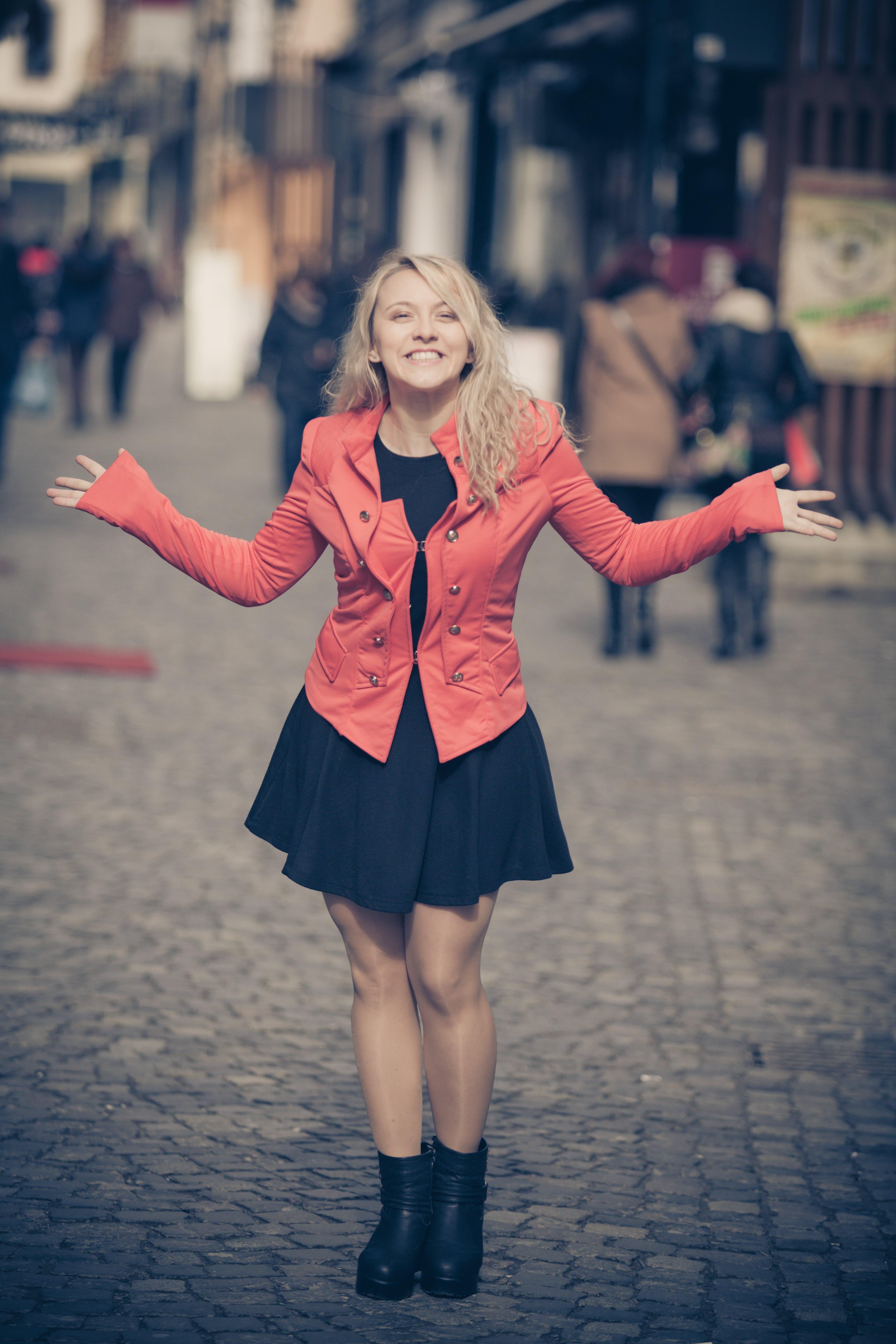 Woman in Red Jacket and Black Skirt