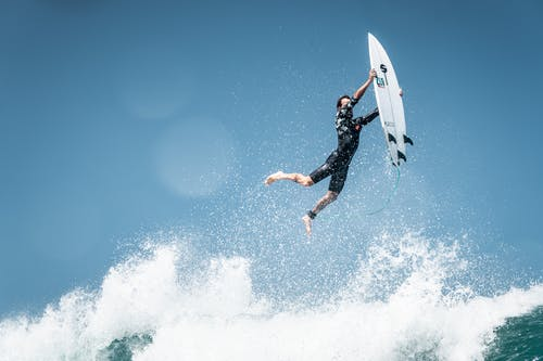 Surfer Falling on Wave