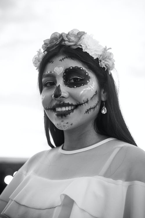 Woman with Face Painted for Dia De Muertos