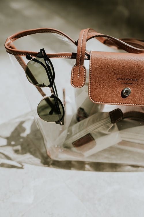 Sunglasses and Transparent Bag