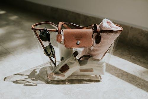 Sunglasses and Towel in Transparent Bag
