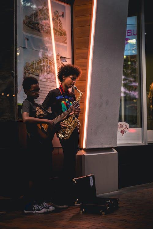 Бесплатное стоковое фото с гитара, город, города