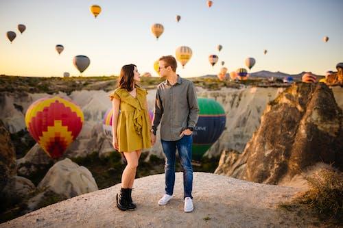 Couple Against Air Balloons
