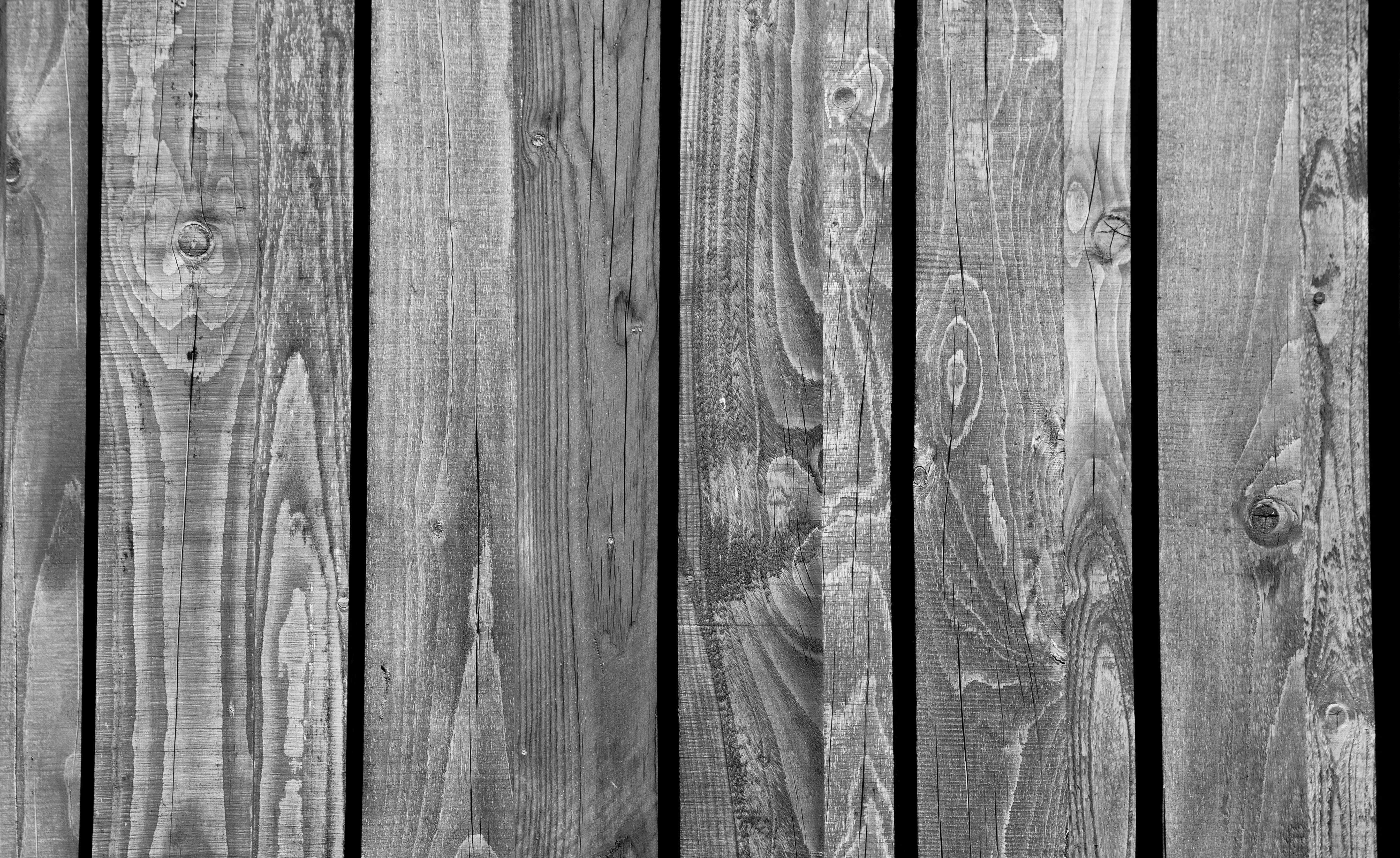 Grayscale Photo of Wood Pallet