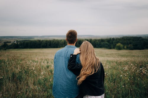 A Back View of a Couple Looking at a Landscape