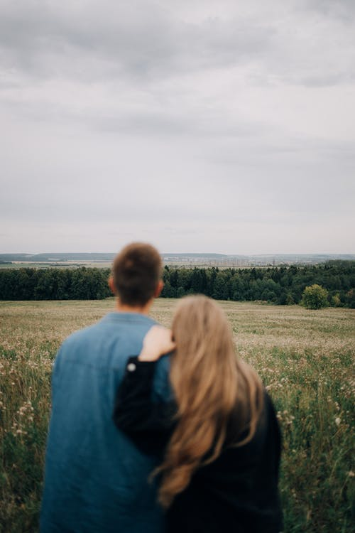 DefocusedBack View of a Couple Looking at a Meadow