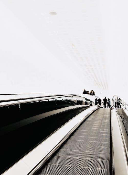 An Incidental People Using Escalator