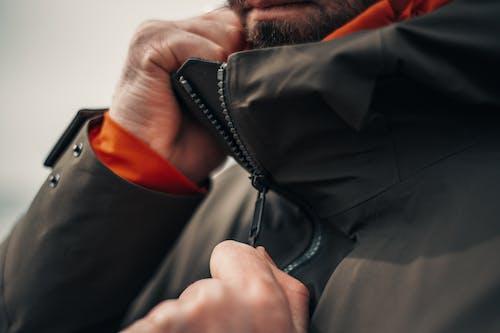 Close-Up View of Man Zipping Jacket