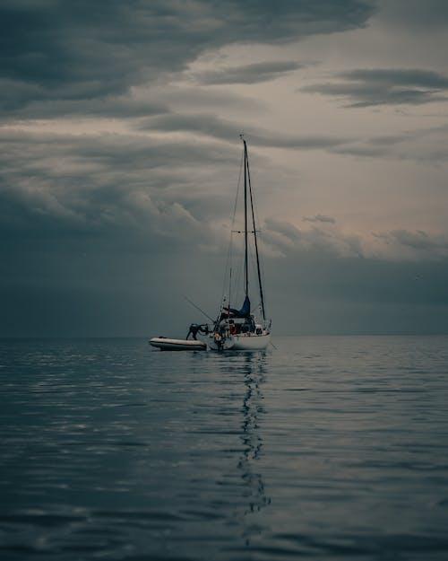 Yacht on Sea Against Cloudy Sky