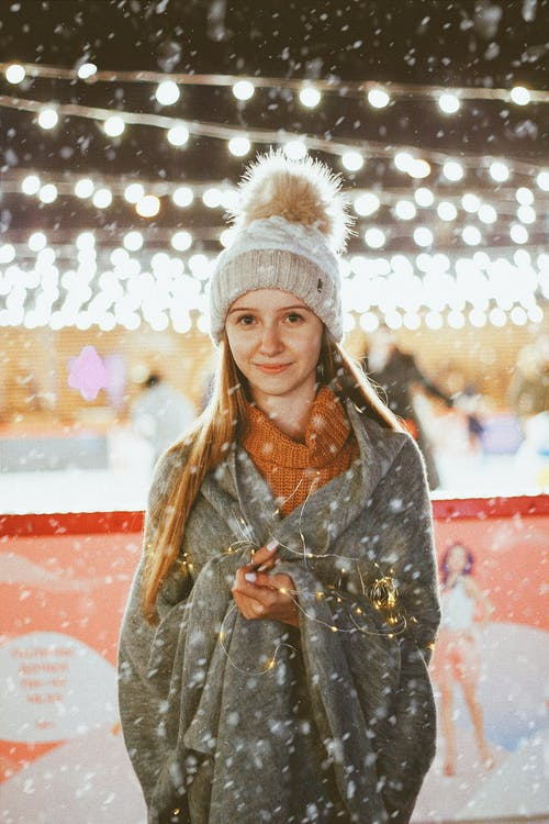 Teenage Girl in Winter Outfit with LED Lighting Wrapped Around Arms