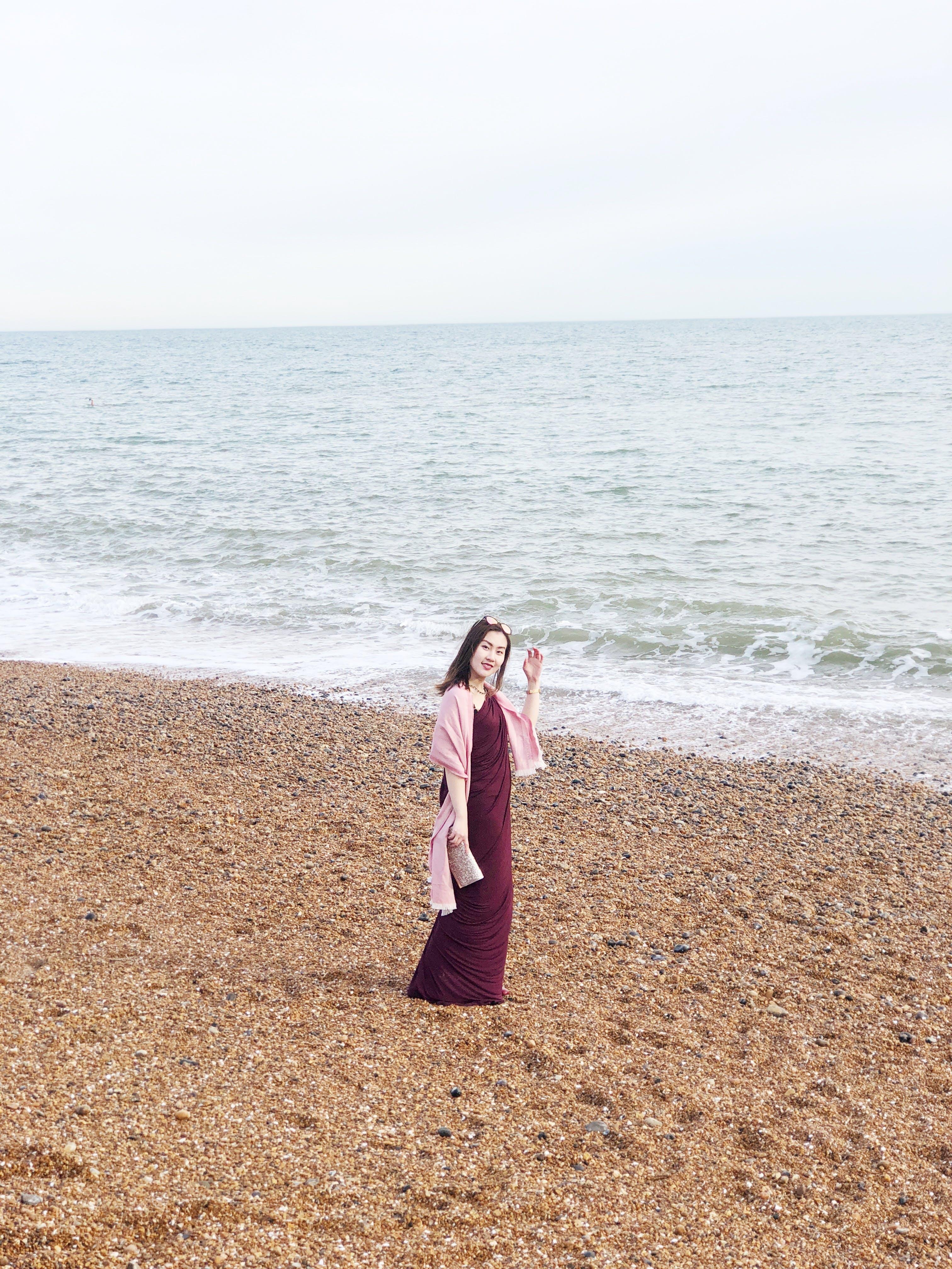 Woman Wearing Maroon Long Dress Near Seashore