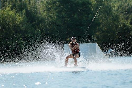 女性, 户外活动, 水上運動 的 免费素材图片