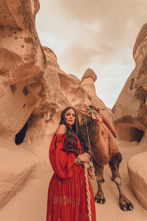 Woman with Camel on Desert
