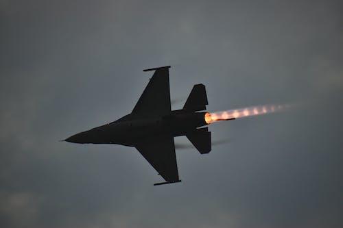 Black Jet Plane in Mid Air