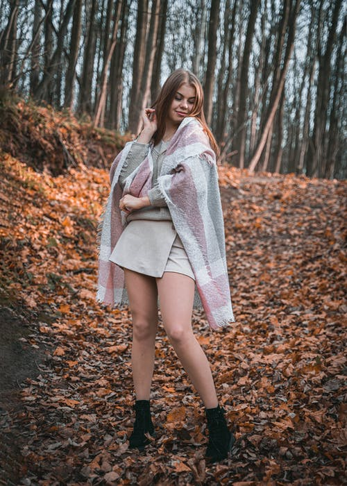 Young Woman Posing in Autumn Forest