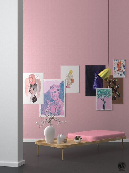 Stylish interior with low table and pictures on pink walls