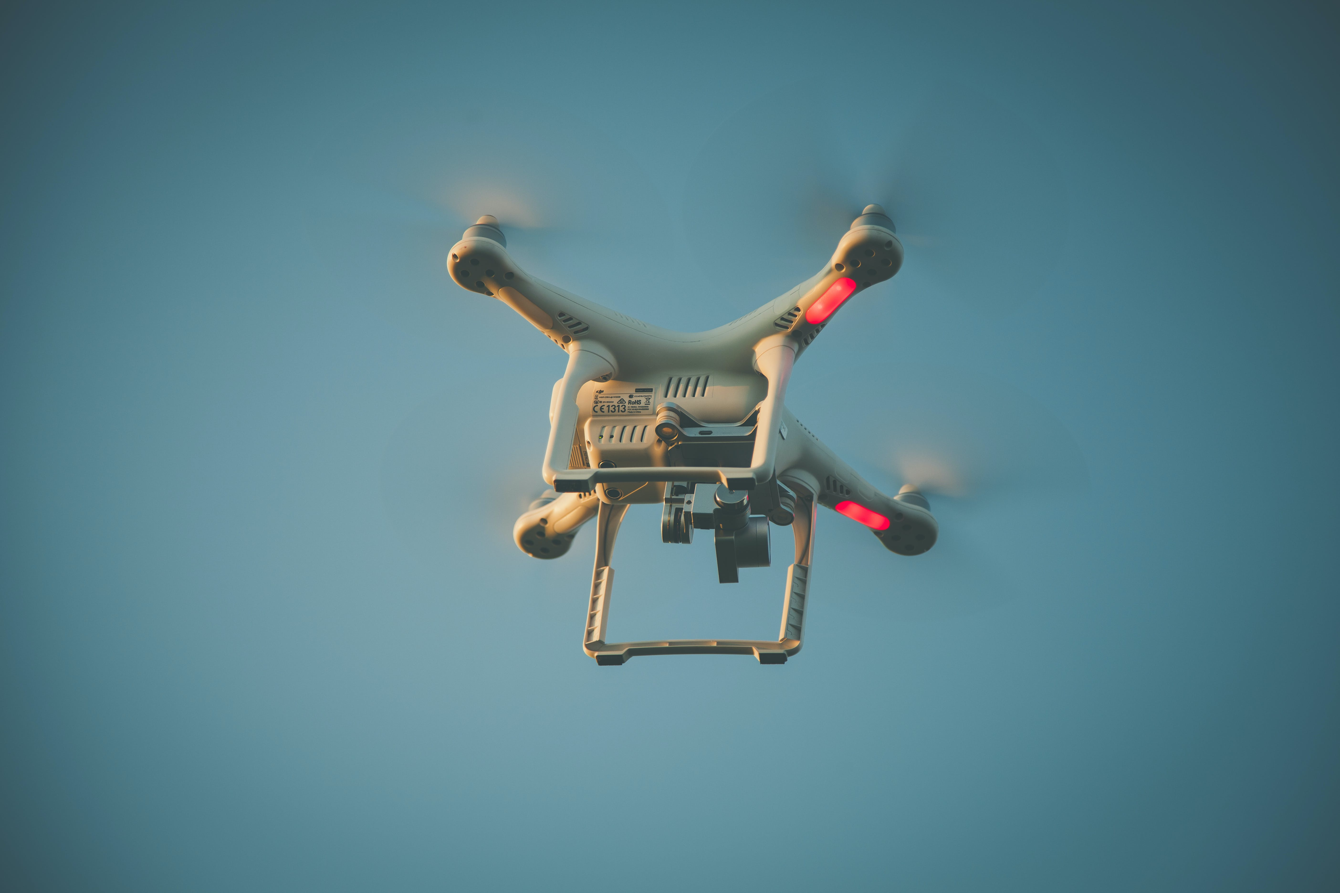 Worm's Eyeview Photo of White Quadcopter