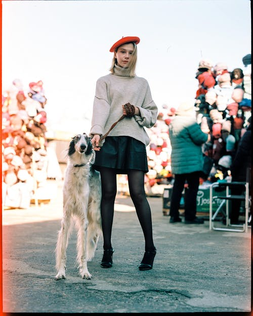 Young Beautiful Woman Posing with Dog