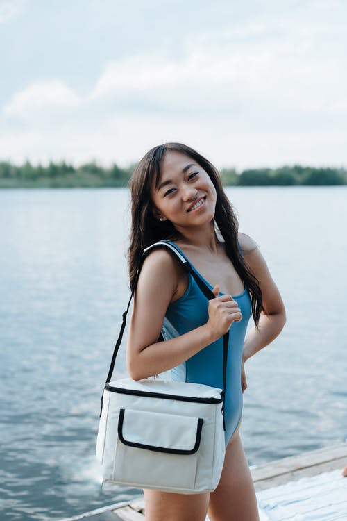 Portrait of Woman With Thermal Bag at Lake