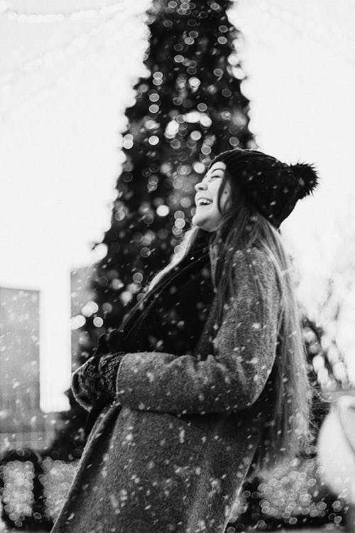Laughing Woman against Christmas Tree