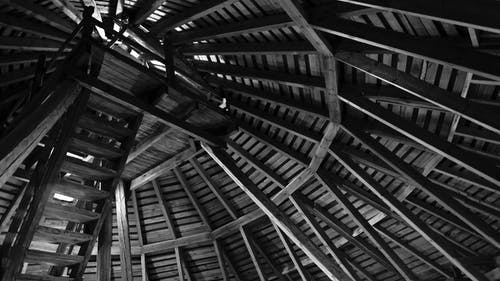 Brown Wooden Ceiling in Grayscale Photo