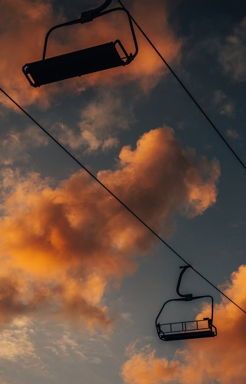 Black Electric Cable Under Cloudy Sky