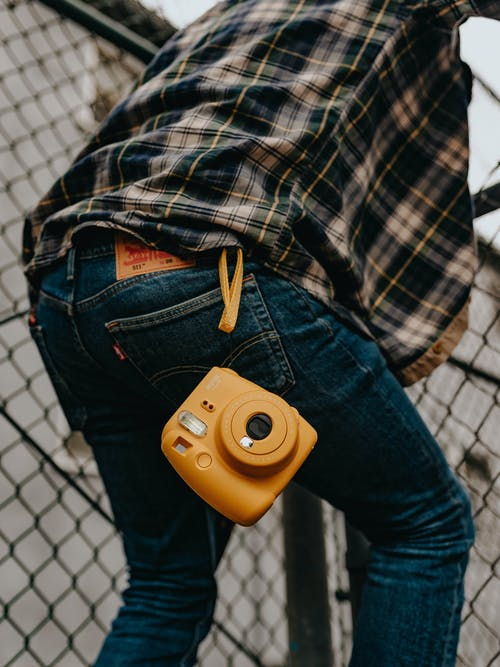 Rear View of Yellow Camera on Jeans