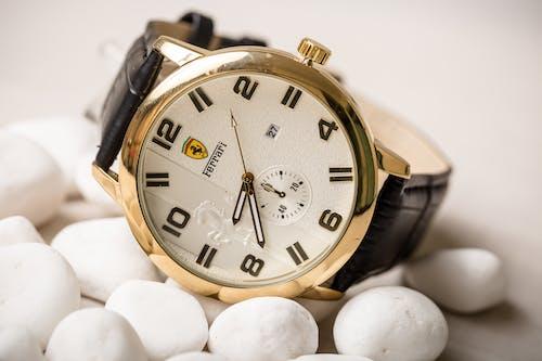 Copper Gold Ferrari Watch Presented on Decoration of White Stones