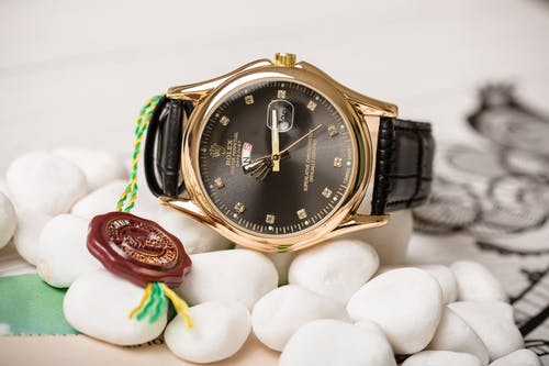 Copper Gold Rolex Brand Watch with Black Dial and Decorations