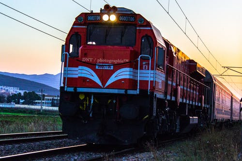 White and Red Train during Golden Time