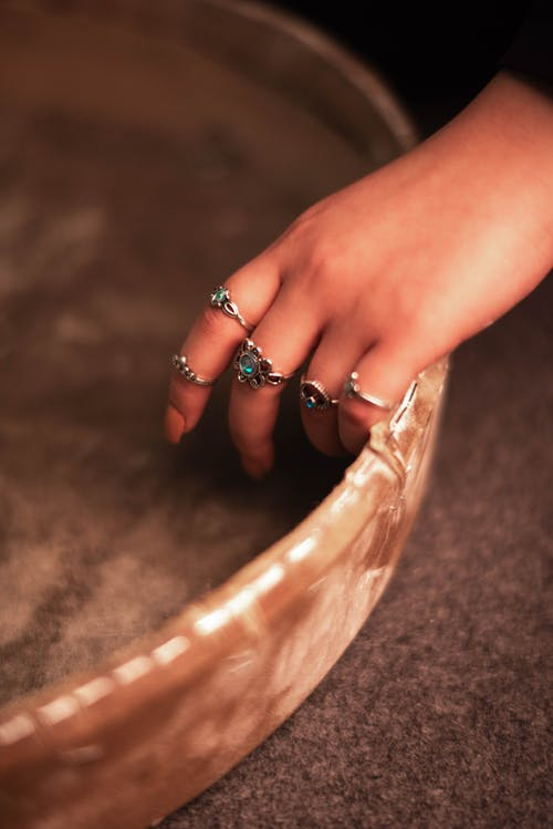 Womans Hand on Bowl on Floor