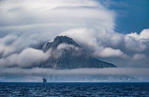 Free stock photo of cliff, clouds, fog