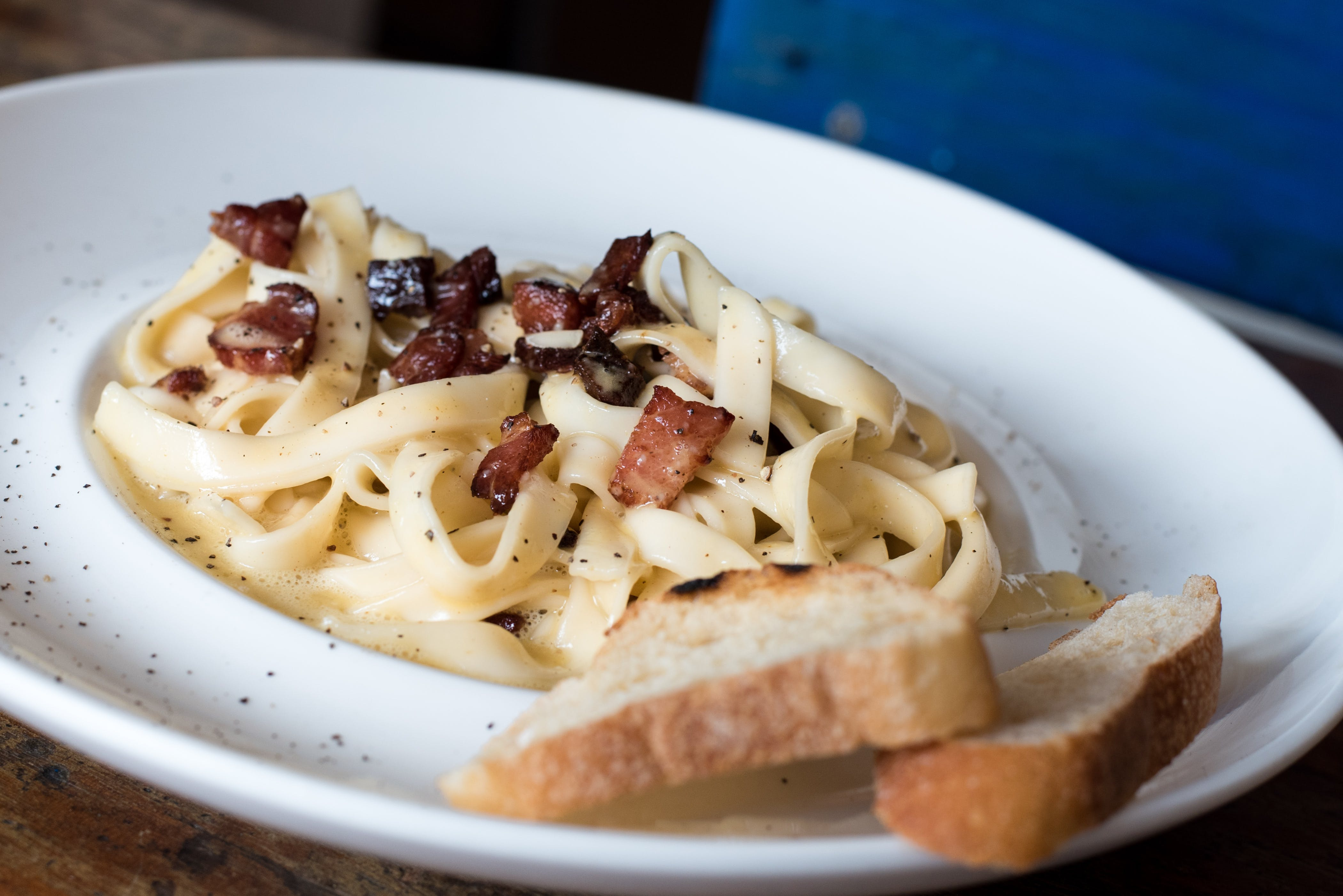 Pasta Dish With Bread on White Ceramic Plate