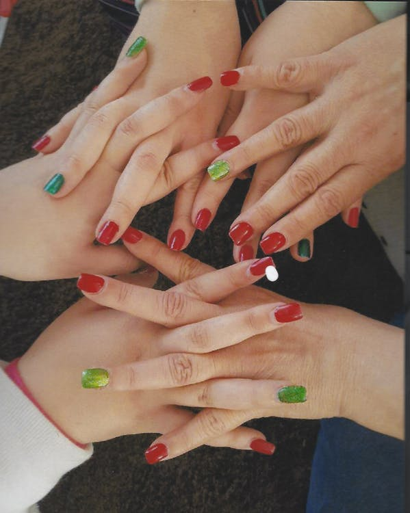 Women Holding Hear Hands Showing Their Nail Polishes