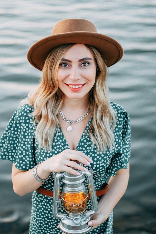 Blond Woman Holding Lantern