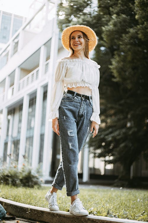 Smiling Woman Wearing Straw Hat in City
