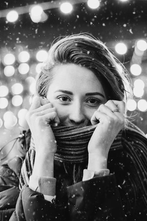 Woman Covering Face with Scarf in Winter