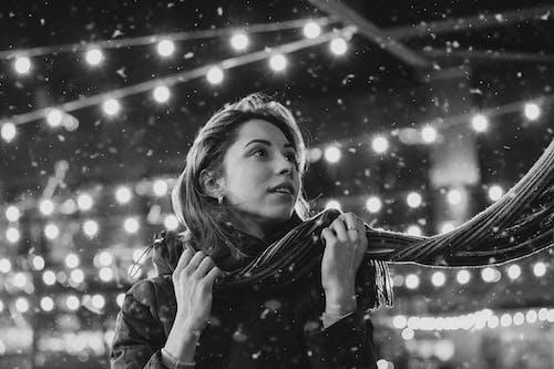 Woman Wearing Scarf in Snowy Winter
